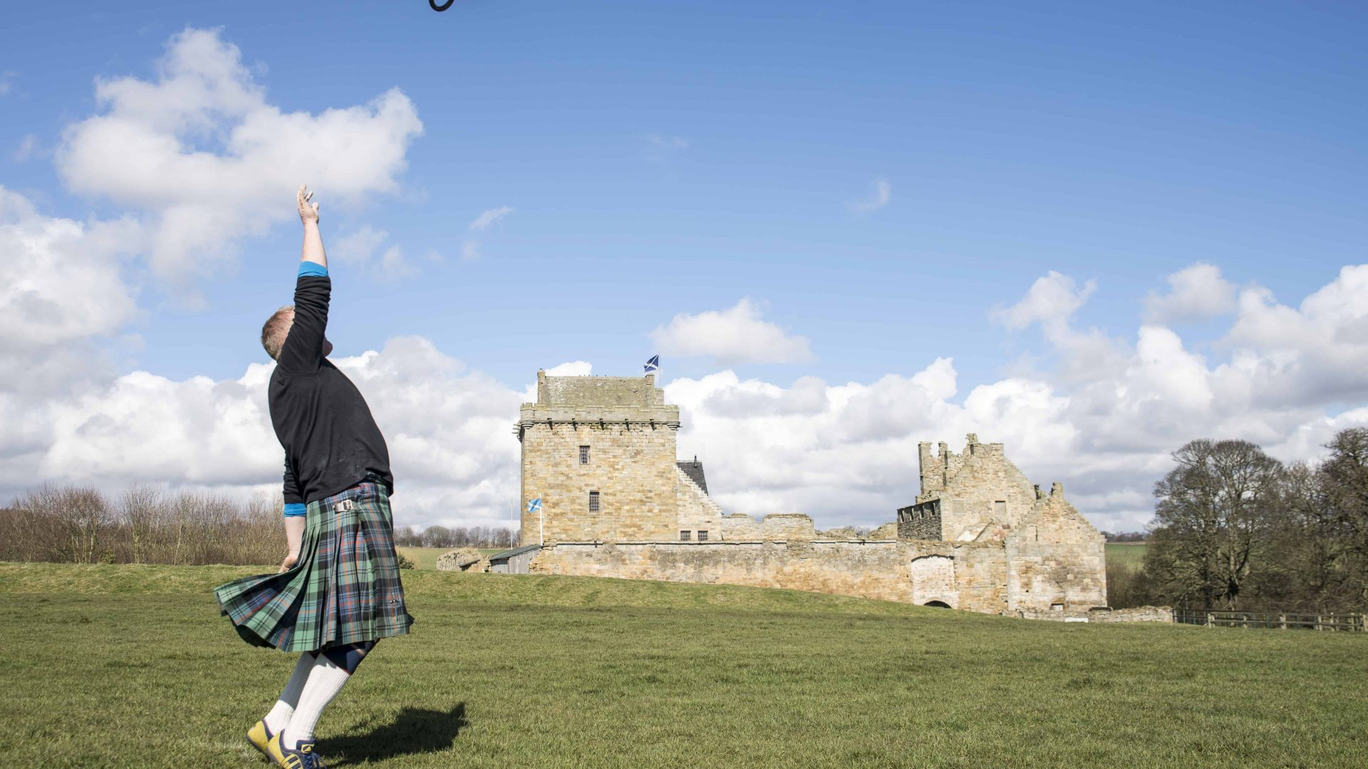 Jamie Barr demonstrating Weight for Height at Balgonie Castle.